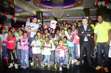 Hotel officials with some of the children who were entertained.