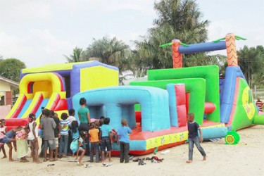 Children at Kuru Kururu form a queue to enjoy the bouncy castle (Photos courtesy of Jenelle Blackman)