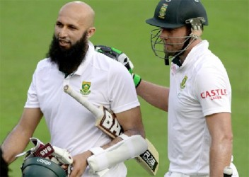 Hashim Amla and AB de Villiers leave the field at Centurion yesterday after hitting unbeaten centuries on the way to their unbroken record fourth wicket stand.