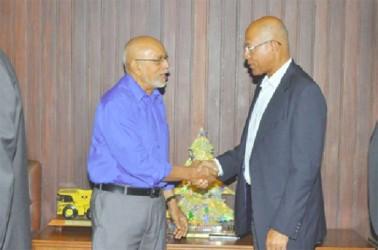 President Donald Ramotar (left) greets Insel Air's Director of International Affairs, Edward Heerenveen