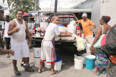 Vendors continued their sales from their vehicles outside of the Bourda Market yesterday morning. (Arian Browne photo)