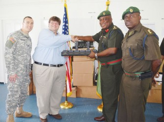US Embassy Chargé d' Affaires Bryan Hunt (second from left) making the presentation to GDF Chief of Staff, Brigadier Mark Phillips. (US Embassy photo)