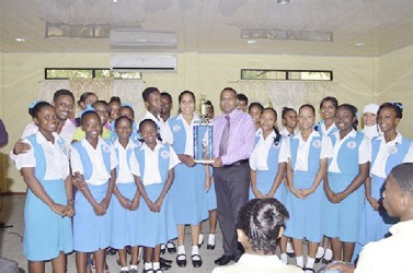 Winner in the large category, St Joseph High School receiving their trophy from Minister of Culture, Youth and Sport, Dr. Frank Anthony (GINA photo)