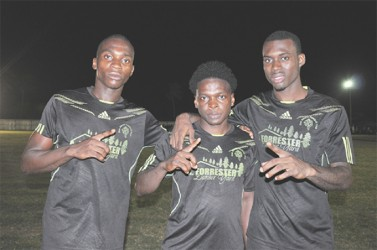 Den Amstel scorers, from left to right- Delon Lanferman, Travis Hilliman and Andre Hector pose for a photo opportunity following their curtailed matchup against Uitvlugt.