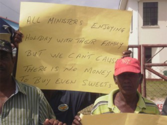 One of the placards carried by the protesting workers