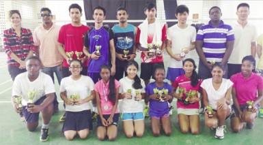 The prize winners following the completion of the annual Woodpecker Products badminton tournament which ended last Saturday at the Queen's College courts.