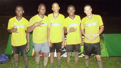 Eagles goal scorers from left to right- Kendolph Louis, Randy Small, Dellon Albert, Kellon Primo and Dellon Charter pose for a photo opportunity following their crushing win over Blueberry Hill Fc