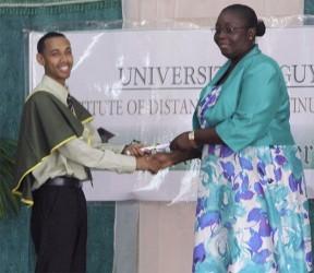 2014 top student Keshri Jailall receiving his certificate