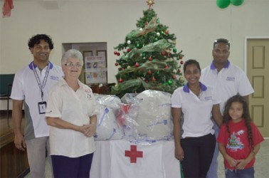 This Copa photo shows staff of the airline with Dorothy Fraser (second from left) of the Red Cross.
