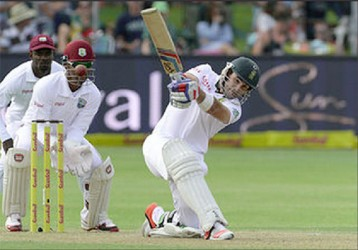Dean Elgar of South Africa drives during day 1 of the 2nd Test match between South Africa and West Indies at St. Georges Park on December 26, 2014 in Port Elizabeth, South Africa. (Photo by Duif du Toit/Gallo Images)
