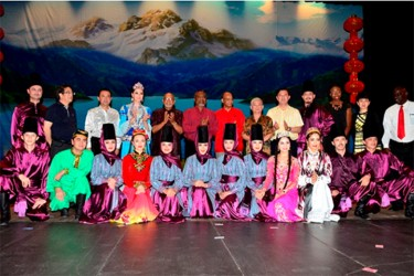President Donald Ramotar, Prime Minister Samuel Hinds, and Home Affairs Minister Clement Rohee with Chinese Ambassador Zhang Limin  take a photo opportunity with Chinese Acrobats at the National Cultural Centre. The event was sponsored by the Ministry of Culture, Youth and Sport and the Chinese Association yesterday. (GINA photo)