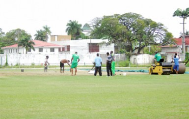 The GCC ground staff working diligently in order to make the venue playable for the next few days. (Orlando Charles photo)