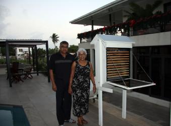 Drs Shoba and Neville Gobin stand near the Solar Dryer