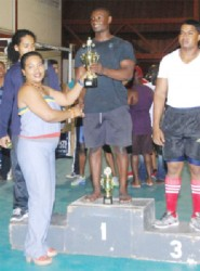 Rudolph Blackman collecting his trophies for winning the overall Junior title. (Orlando Charles photo)