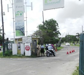 Police ranks at the main entrance of the University of Guyana yesterday morning.