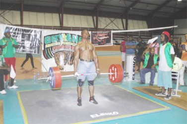 Randolph 'The Accomplisher' Morgan dead lifting 701 pounds (raw) on Sunday at the National Gymnasium. (Orlando Charles photo)