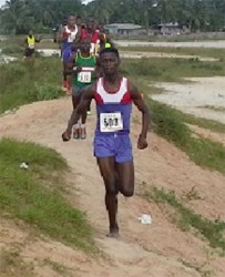 Early pace setter, Nathaniel Giddings leads the runners through the terrain in Linden.