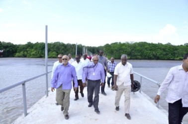 GPL's CEO, Bharrat Dindyal (centre) with President Donald Ramotar and other officials during a visit to the submarine cable