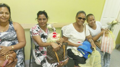 The happy faces of four cancer patients who received roses and gift hampers yesterday from Giftland OfficeMax.
