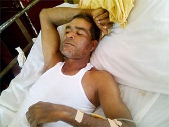 Danny Narayan in his hospital bed at Suddie