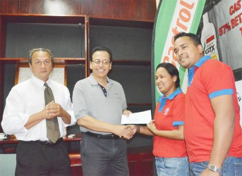 Guyoil's brand manager, Nadia Sugrim handing over the company's sponsorship to Howard Cox of the GBBC.
