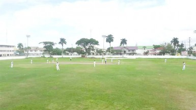 Action between U15 champs Demerara and President's XI yesterday at DCC