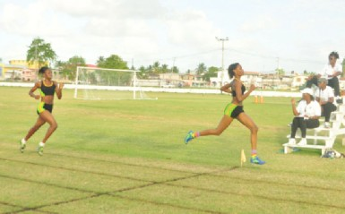 Running Brave Athletic Club's Natricia Hooper powers across the finish line to win the 300m open female event. (Orlando Charles photo)