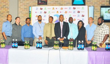 GFF Normalization Committee Chairman Clinton Urling (sixth from left) posing for a photo opportunity alongside other members of the launch party inclusive of Kashif and Shanghai Co-Directors Aubrey Major (fourth from right) and Kashif Mohammed (fifth from left) following the conclusion of the event's unveiling