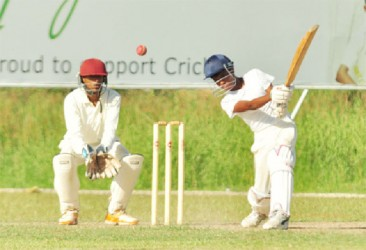 Action between Berbice and the President's XI yesterday at the Everest Ground