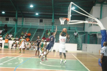 The Colts' Shelroy Thomas (no.15) attempts a jump shot during his side's huge victory against Linden's Bankers Trust Falcons.