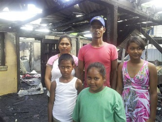 Cane harvester Delon Ramalho, his wife, Angela, and their three children, who lost their home in a fire at Port Mourant on Wednesday morning.