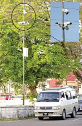 Big brother is watching: Police are now using the CCTV cameras, like the kind pictured here at the junction of Camp and Lamaha streets, to prosecute errant drivers. (Phtotos by Arian Browne)