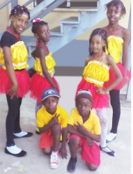 This composite photo shows the children on Friday morning before they left for Calcutta, Mahaicony. Standing from left are Asiyah Abel and Azaliah Fraser, six, while standing from right are Atesha Woolford and Martina Persaud. Kneeling in front row are Joel Justin Abel (right) and Rayden Abel.