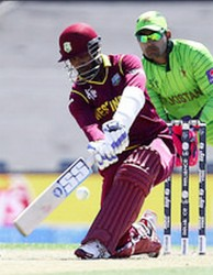 Wicketkeeper Denesh Rammdin, left and Lendl Simmons scored up tempo half centuries in the West Indies score of 310-6. (Photo WICB media)