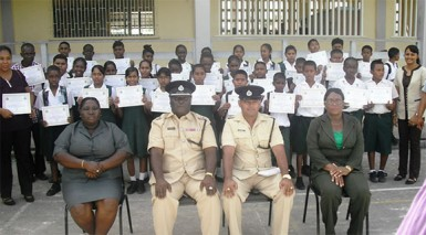 Deputy Commander, Stephen Mansel and others pose with the graduating students