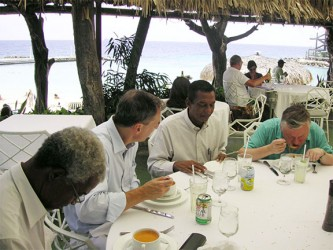 Anatoly Karpov, the 12th World Chess Champion, is pictured at extreme right having lunch at a hotel in Curacao. Seated on his immediate right is Stabroek News chess columnist Errol Tiwari. The picture was taken in 2010.