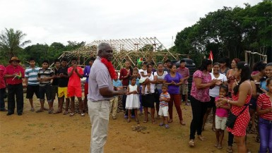 Works Minister Robeson Benn interacting with Region One residents. (Ministry of Public Works photo)