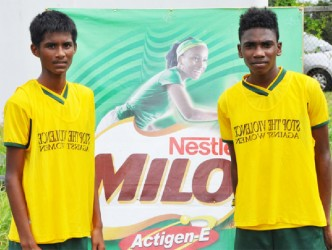 Mae's Secondary sharp-shooters Darshan Persaud (left) and Hakiem Hutson pose for a photo opportunity following their win over the School of the Nations