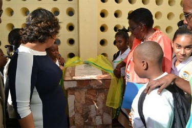 Minister of Education, Priya Manickchand (left) along with students during the unveiling of the plaque to commission the elevation of the North Ruimveldt Secondary School. (GINA photo)