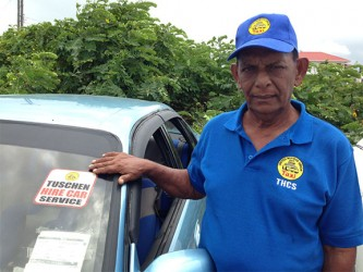 President of the THCS, Sheik Mohamed points to the sticker on his car