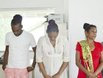 From left to right: Joseph Adams, 25, Fabiola Adams, 28, and their mother, Khumwatte Narine Adams, 49 who were charged with trafficking in narcotics and being accessories to drug trafficking (Photo: Emily Costa / Globo 1)