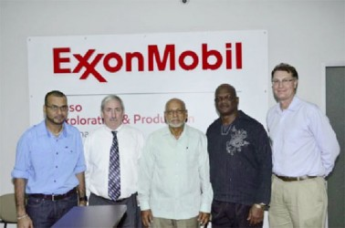 President Donald Ramotar (centre), Natural Resources and the Environment Minister, Robert Persaud (left) and ExxonMobil Country Manager,  Jeff Simon (second from left) along with staff at ExxonMobil's Head Office, New Market Street (GINA photo)