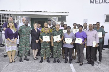 Mary Kratz (third from left in front row) is seen with GDF Medical Corps staff who were trained and others. (GDF photo)