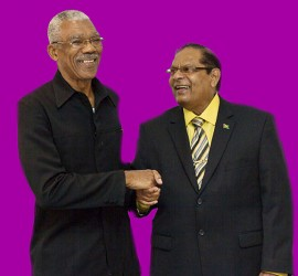 APNU+AFC Presidential candidate David Granger (left) and Prime Ministerial candidate Moses Nagamootoo shake hands at the formal launch of the alliance yesterday at the Guyana Pegasus. (APNU+AFC photo)