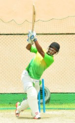 West Indies player and Guyana Captain Leon Johnson smashes one out of the nets during the team's final session