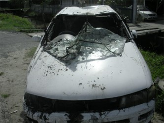 The damaged car that was used in the robbery.