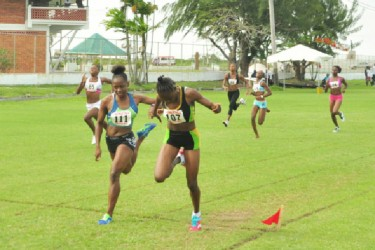 Kenisha Williams, wins the girls U-18 100 metres yesterday in a driving finish. (Orlando Charles photo)