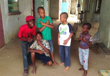 These boys who were home early after a double session at school, were happy to have their photo taken
