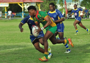Guyana's Claudius Butts on his way to record a try yesterday against Barbados. (Orlando Charles photo)