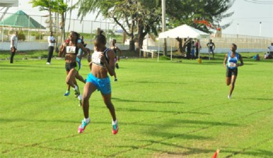 Kenisha Phillips powering across the line in the under-18 200m event yesterday. (Orlando Charles photo)